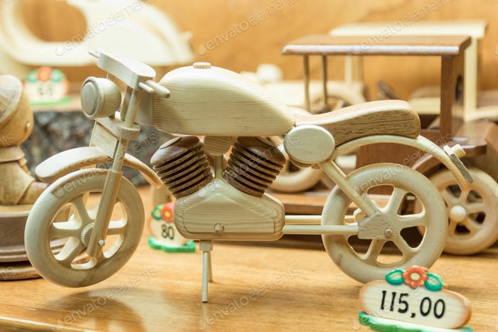 wooden hand-made toy motorcycle in the window of the wooden toys store in Rome