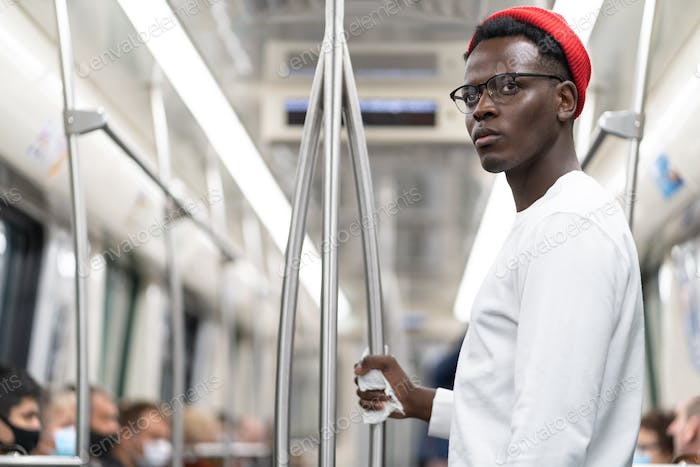 Black man does not want to wear a face mask in public transportation during covid-19