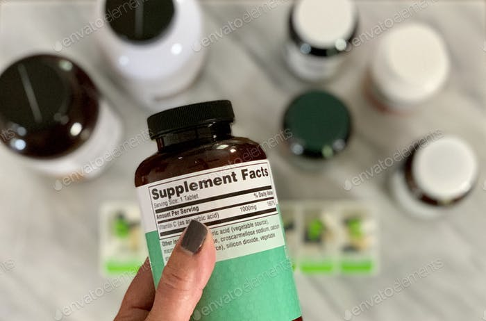 Reading the label on supplement bottle