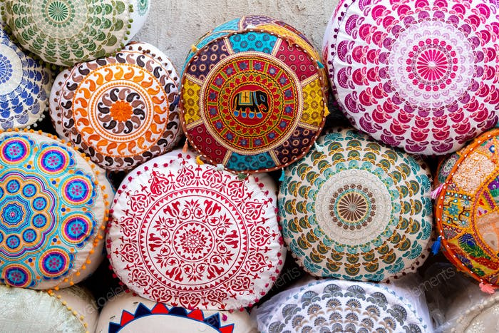 Colorful cushions with ornaments at the market