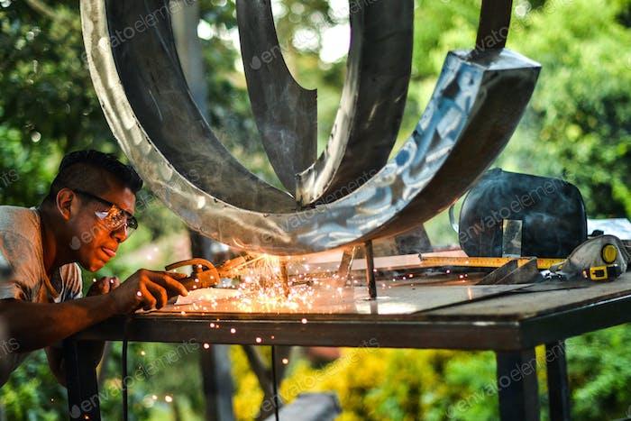 Welder on Artist Sculpture
