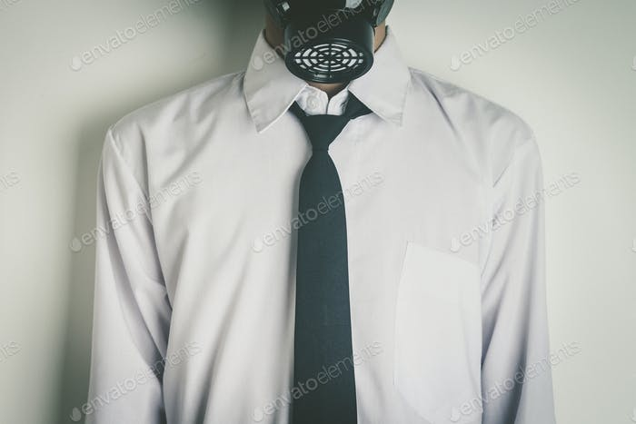 Office worker wearing a gas mask.
