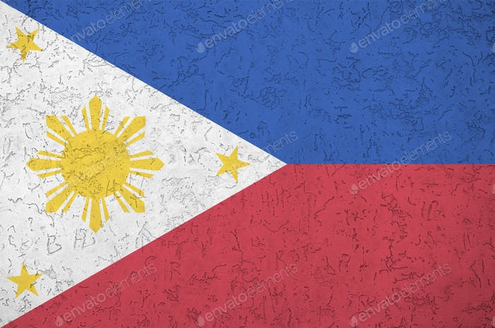 Philippines flag depicted in bright paint colors on old relief plastering wall close up