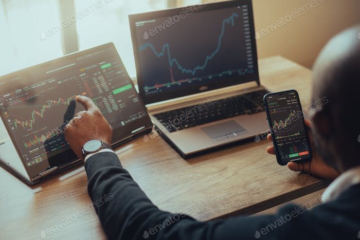 Young man online trading crypto currency