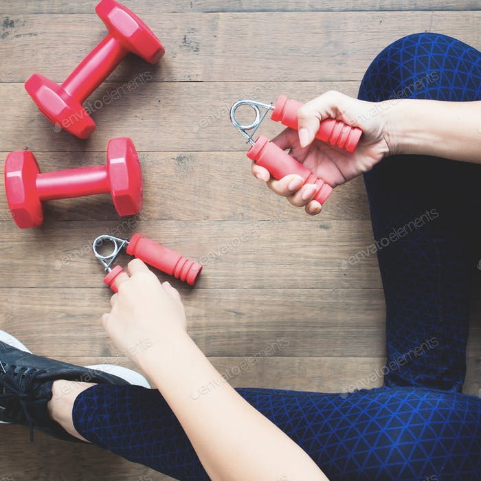 Woman in fitness clothing using sport equipment. Fitness and Diet, Healthy Lifestyle concept