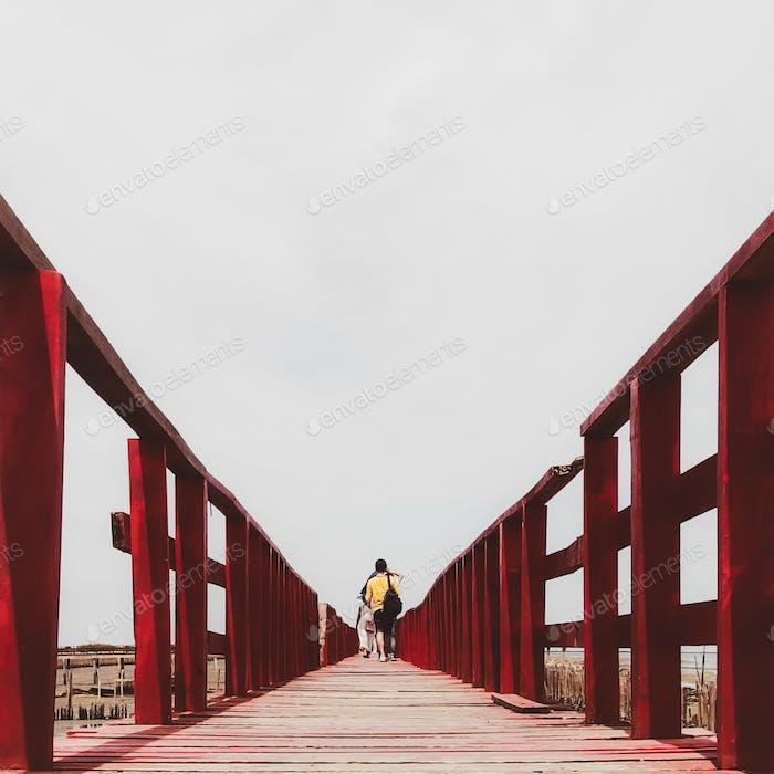 People walk on red bridge, taken at Samut Sakhon