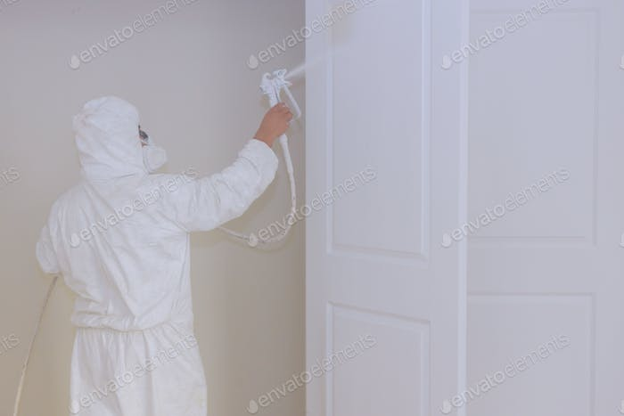 Master painting wood doors with spray gun processing painting base door house