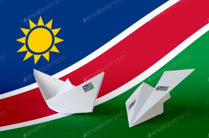 Namibia flag depicted on paper origami airplane and boat. Oriental handmade arts concept