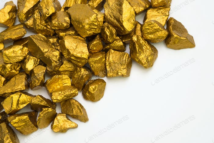 A pile of gold nuggets or gold ore isolated on white background