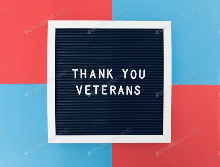 Thank you Veterans sign board on blue and red background to salute our dearest veterans