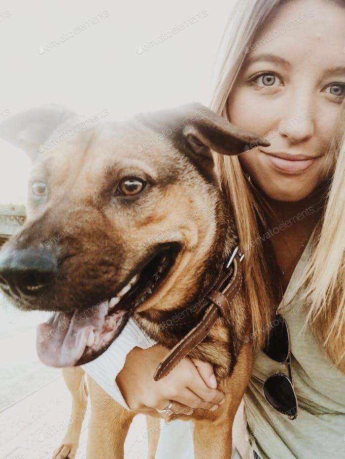 girl and smiling dog