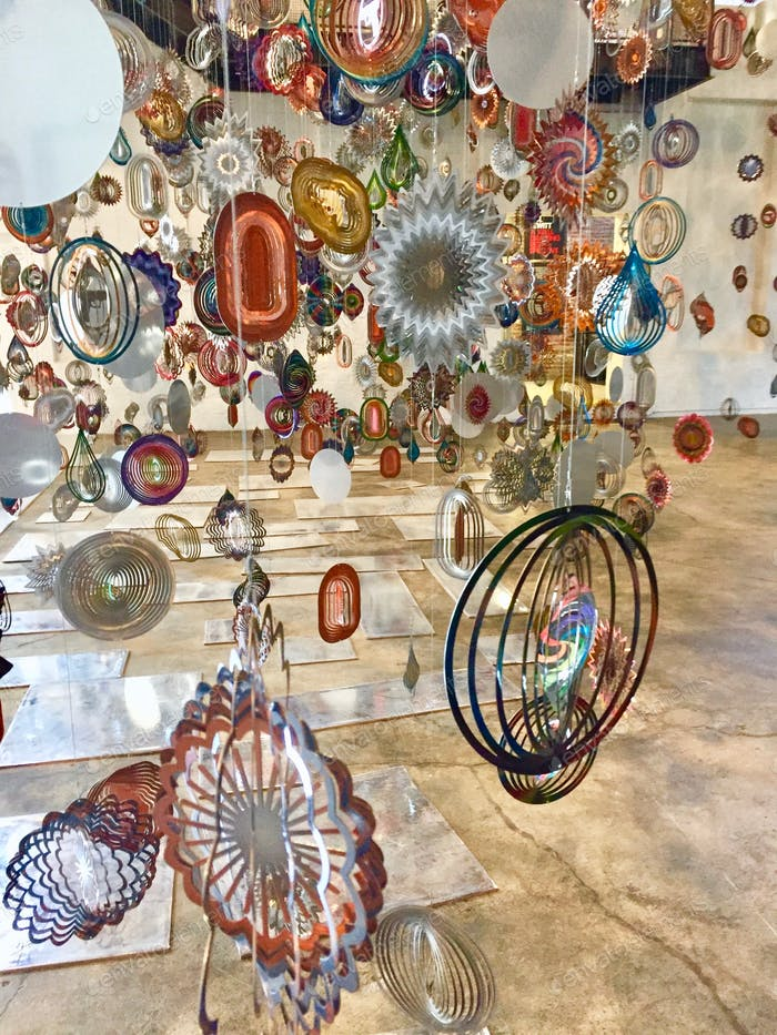 Colorful, twirling, metallic art installation at a museum of contemporary art.