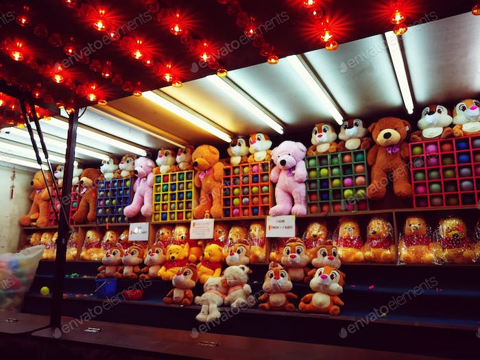 prize plush toys on display at the carnival amusement park. nobody