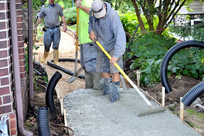 Landscapers  installing a concrete pathway, home improvement!