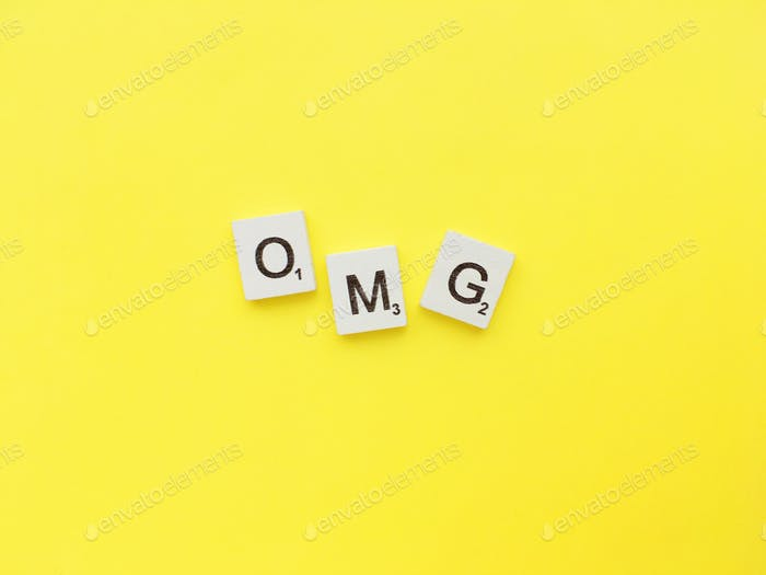 OMG scrabble letters word on a yellow background