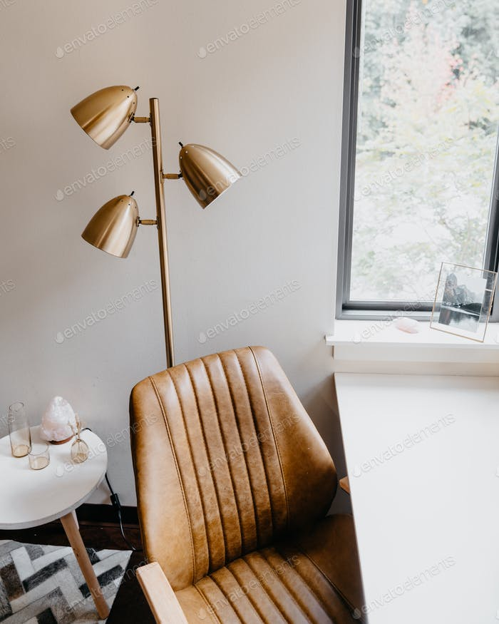 Desk chair and floor lamp in small space design