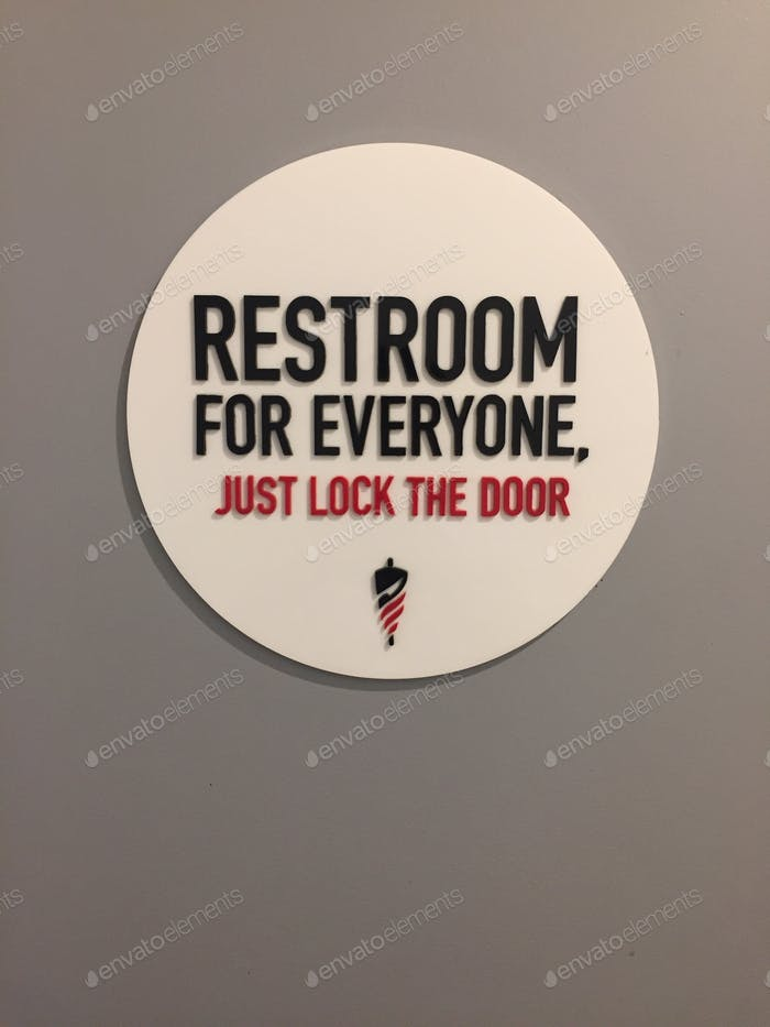 Divertido signo de baño neutro de género.