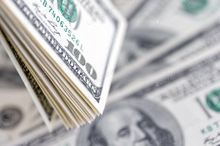 Stack of hundred dollar bills, banknotes of hundred