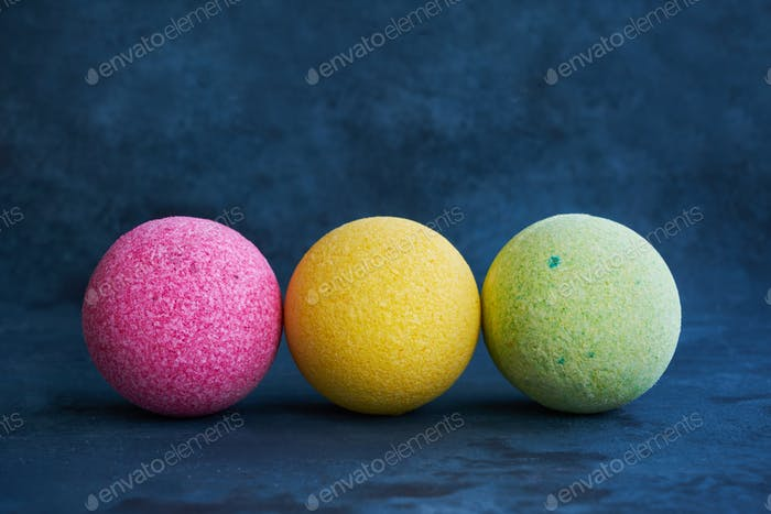 Colorful bath bombs on blue background