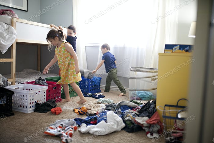 Kids sorting laundry at home on laundry day
