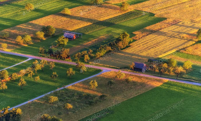 Countryside and farmland at sunset.