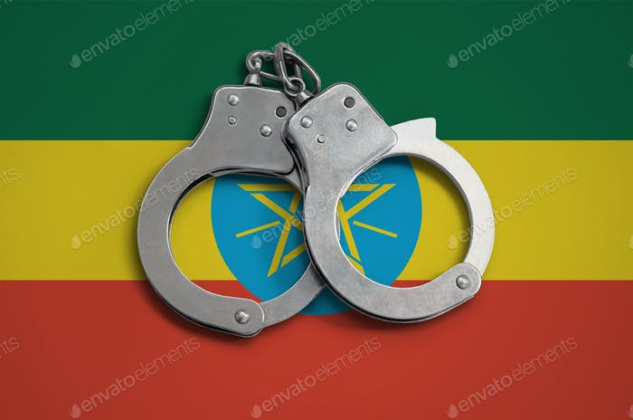 Ethiopia flag  and police handcuffs
