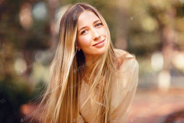 ⭐️⭐️⭐️ Nominated ⭐️⭐️⭐️   Portrait of woman with long blonde hair outdoor