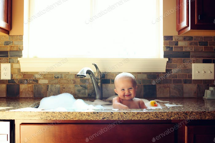 bubble bath in the kitchen sink!