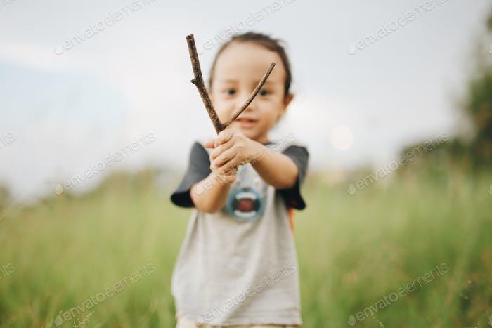 boy playing twigs