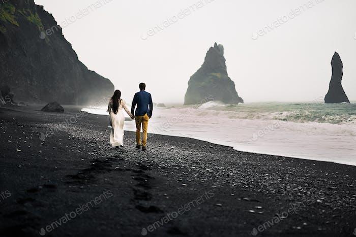 Strolling on the black sand beach