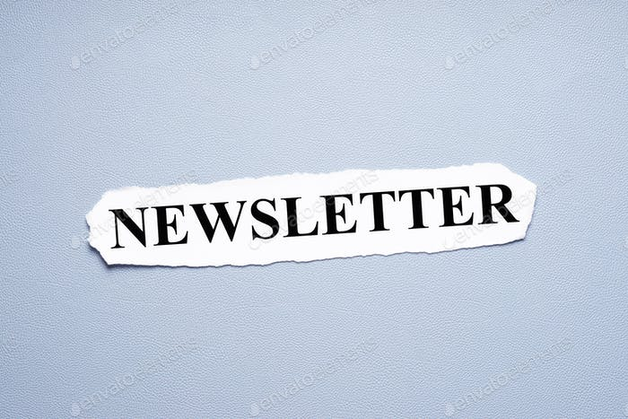 newsletter in upper case letters printed on torn piece of paper