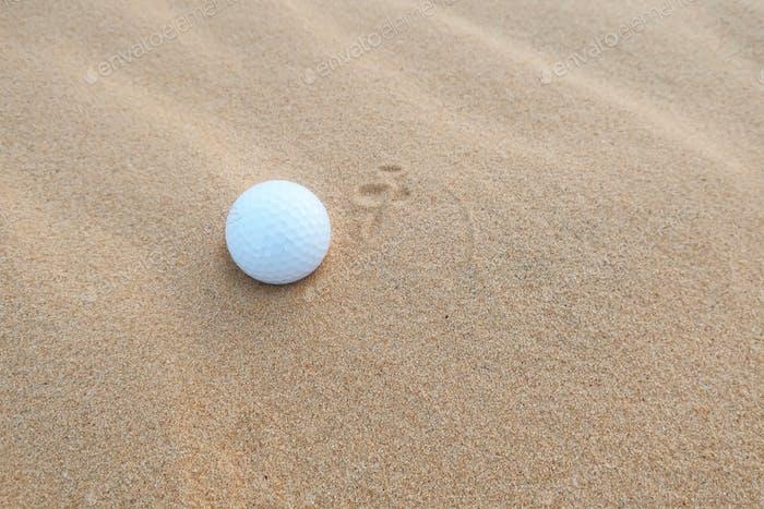 Golf is on sand bunker