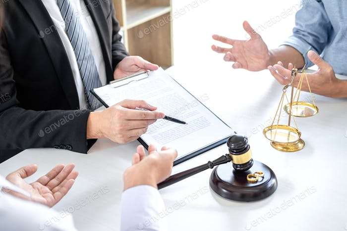 Man and wife conversation during divorce process with male lawyer or counselor