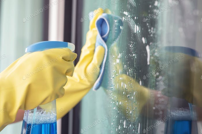 Staff are cleaning aluminum glass to prevent corona virus