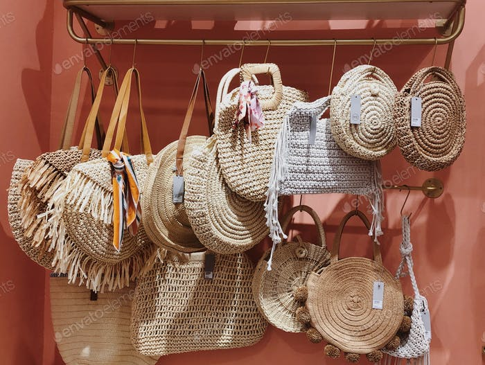 Woven baskets and bags on the display in the retail shop