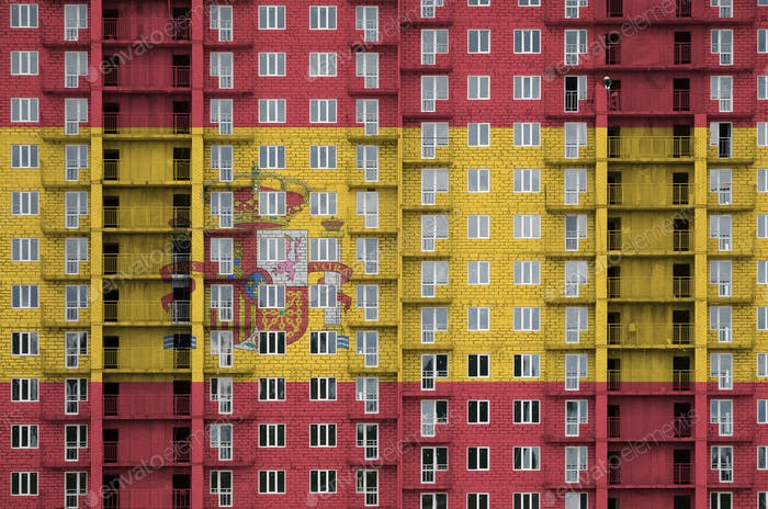 Spain flag depicted in paint colors on multi-storey residental building under construction