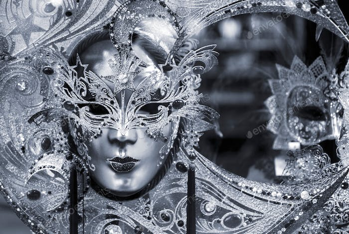 Blue colored picture of traditional carnival mask in Venice, Italy