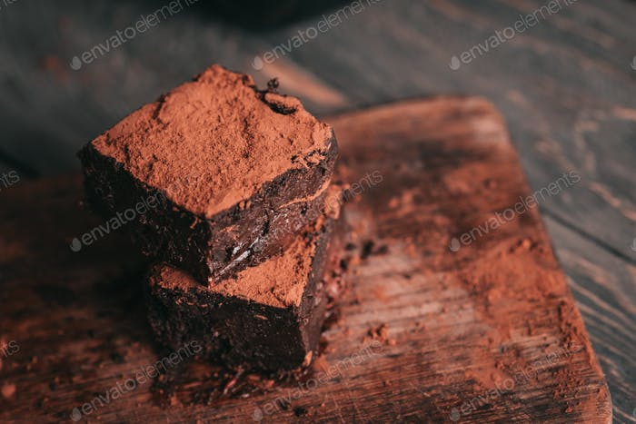 Decadent moist dark chocolate stout beer brownies cut in squares.
