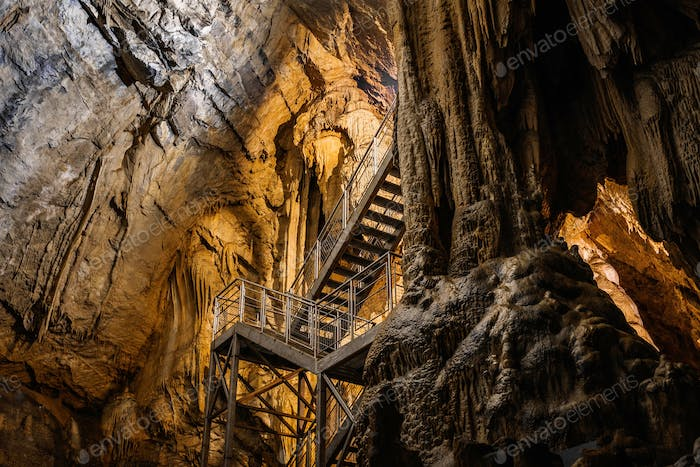 Formations inside cave with stalactites and stalagmites. Karst underground cave.
