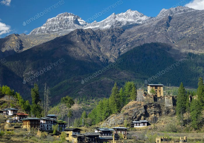 Drukgyel Dzong and the Himalayas in The Kingdom of Bhutan - land of the Thunder Dragon.