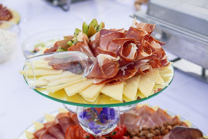 Cold cuts at a banquet. Ham, prosciutto, cheese, food, eating.