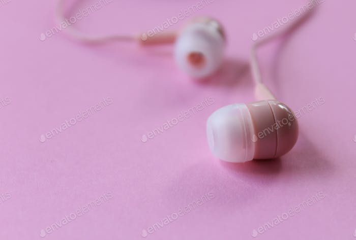 Pink background with pink ear buds