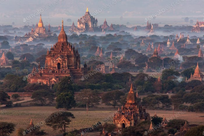 Aerial view of the temples of the Archaeological Zone in Bagan in the early morning sunlight