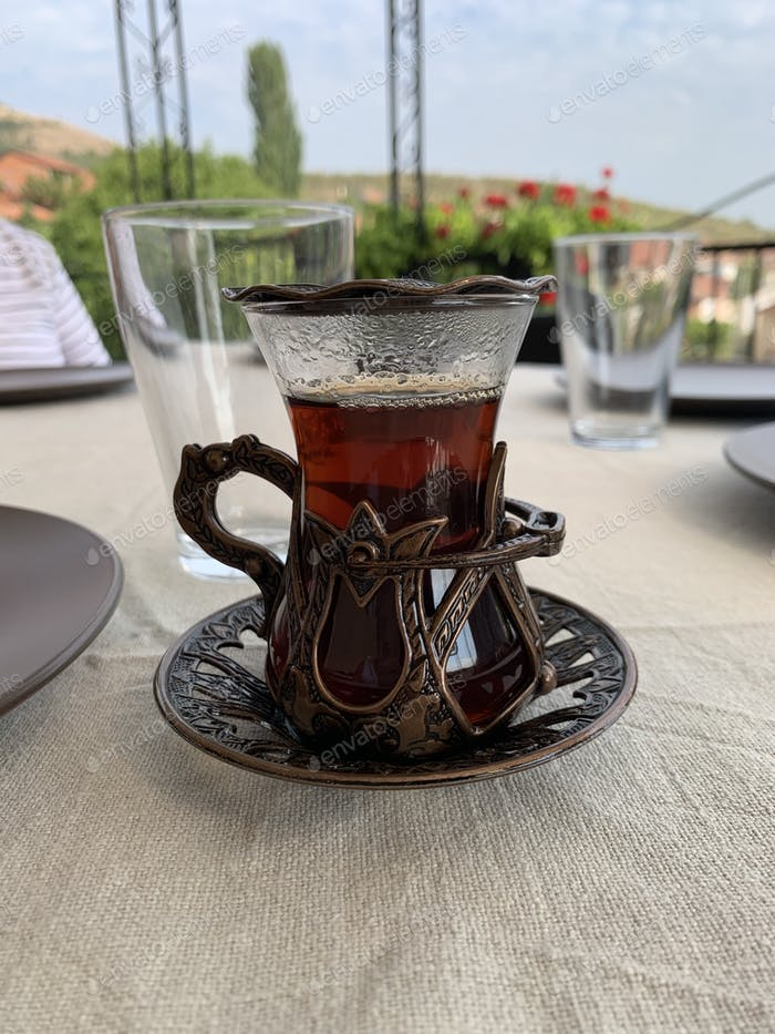 Mug full with tea on the breakfast table