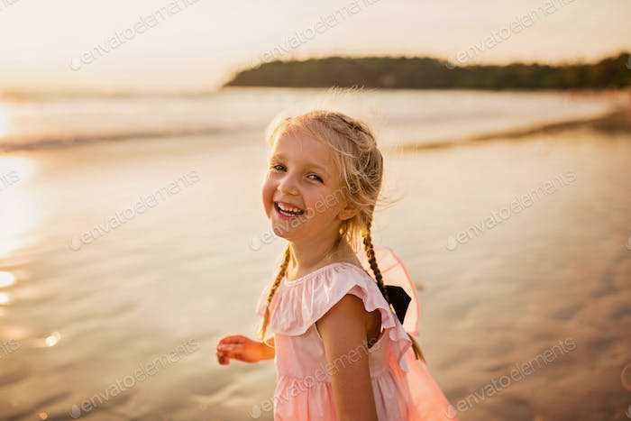 ⭐️⭐️⭐️ Nominated ⭐️⭐️⭐️   Happy little girl with blonde hair on the beach