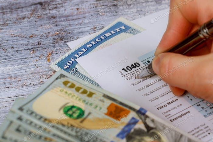 Detail closeup of current tax forms for IRS filing pay tax