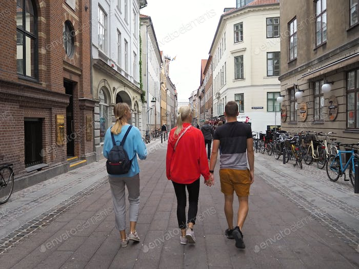NOMINATED!! People from behind; young people walk the streets of Copenhagen.