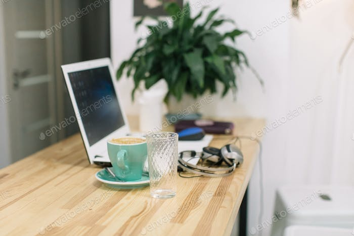 Concept of freelance working. Concept of blogging. Interior in scandinavian style.