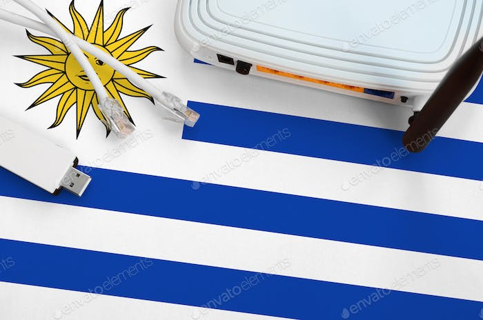 Uruguay flag depicted on table with internet rj45 cable, wireless usb wi-fi adapter and router