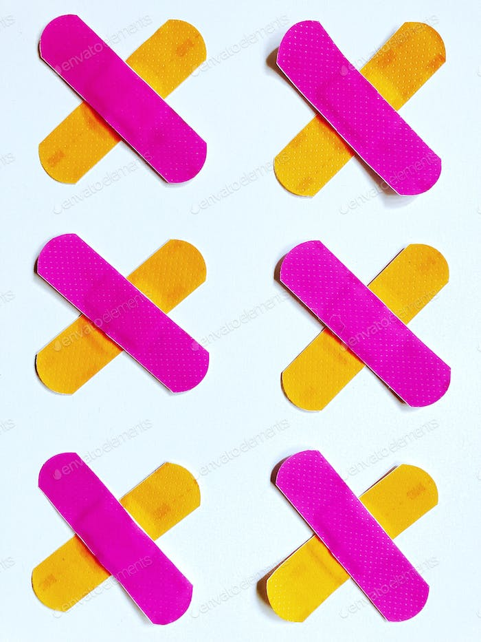 Bright and bold colors. Vibrant and colorful bandages. Hot pink and orange plasters.